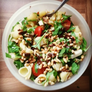 Pasta salad with mozzarella, cherry tomatoes and balsamic dressing